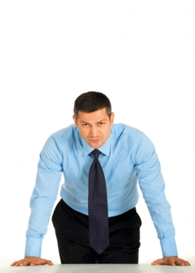 Man leaning over table aggressively